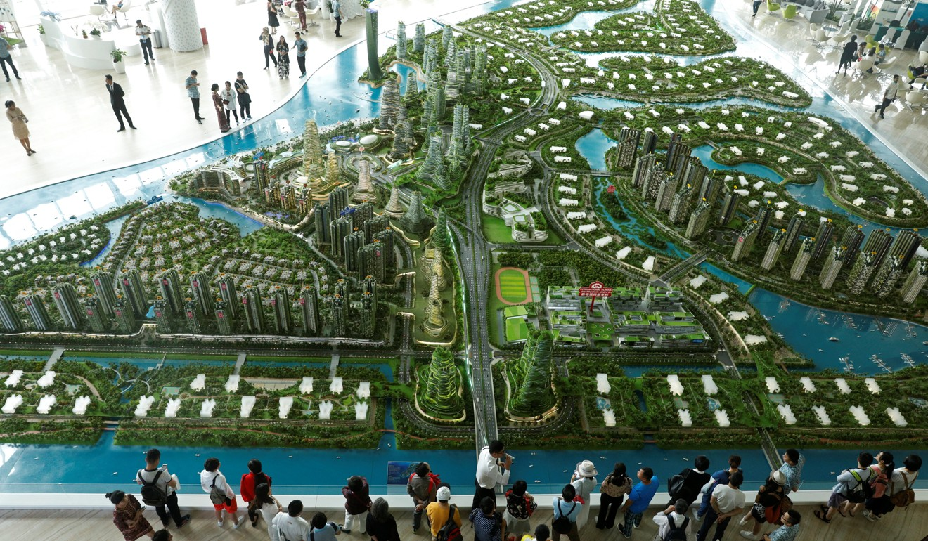Why Are Middle Class Chinese Moving Their Money Abroad This Week Wiring China Many Investors Were Forced To Pull Out Of Malaysias Forest City Development Photo Reuters