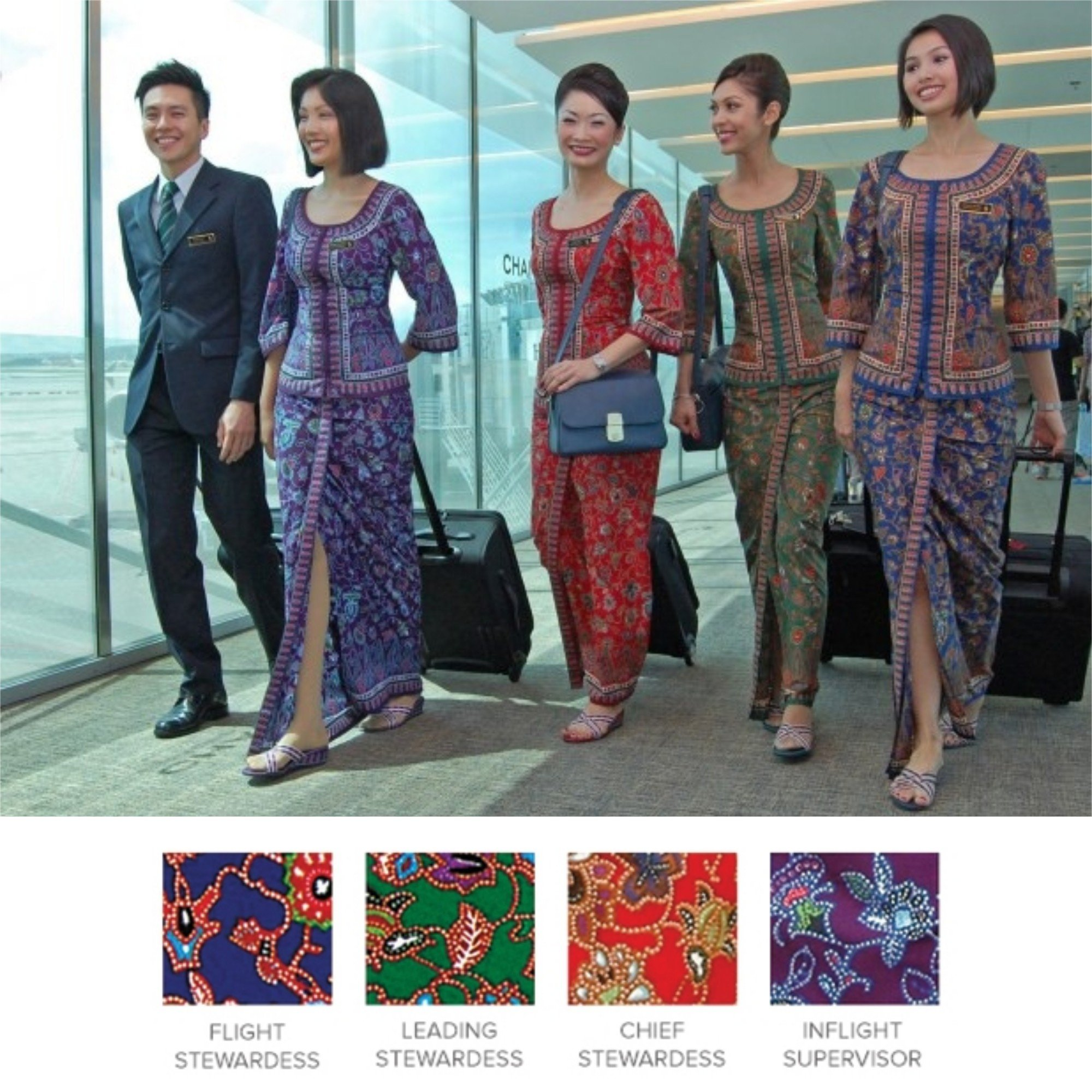 Four coloured uniforms represent the designations of the Singapore girl who wear them
