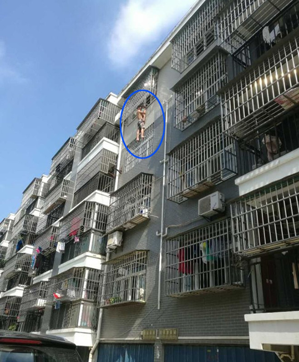 Image result for Daring neighbour saved 3-yr-old girl dangling from fourth floor window
