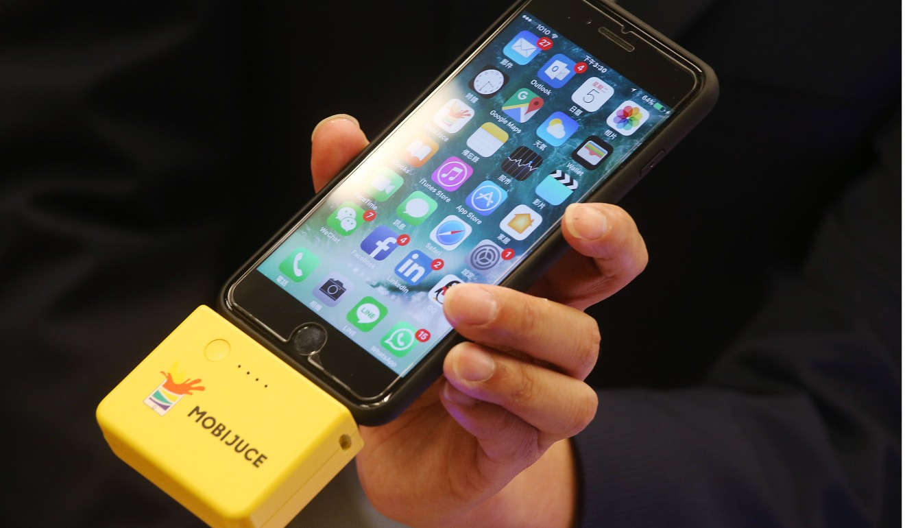 Power banks allow smartphone users to charge their devices on the go. Photo: K. Y. Cheng