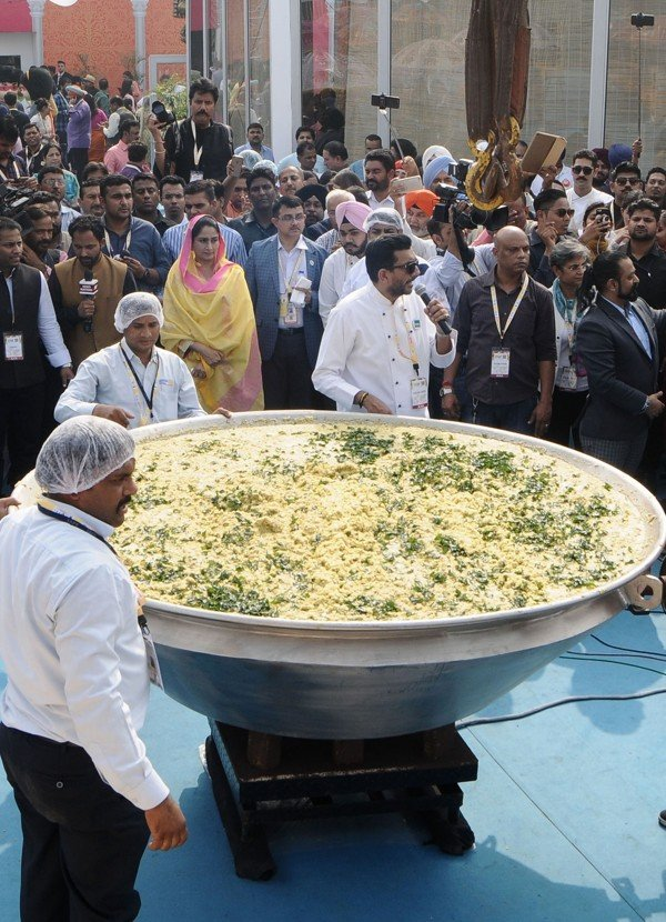 How khichdi mix of lentils and rice became indias national dish chef sanjeev kapoor speaks at a world food india 2017 event that saw a huge wok of khichdi cooked up picture anadolu agency forumfinder Images