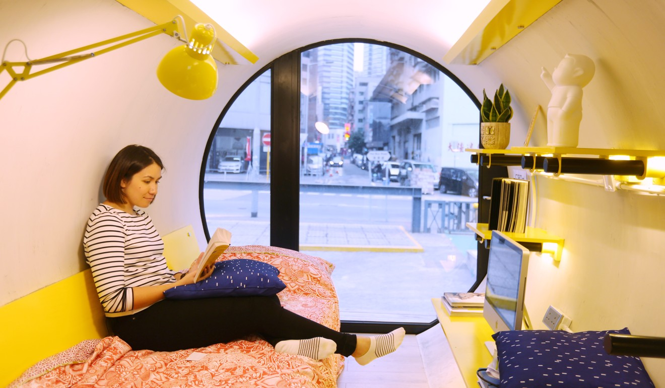 Reporter Alkira Reinfrank relaxes before bedding down for the night in an OPod, built from two lengths of concrete drainpipe. Photo: Xiaomei Chen