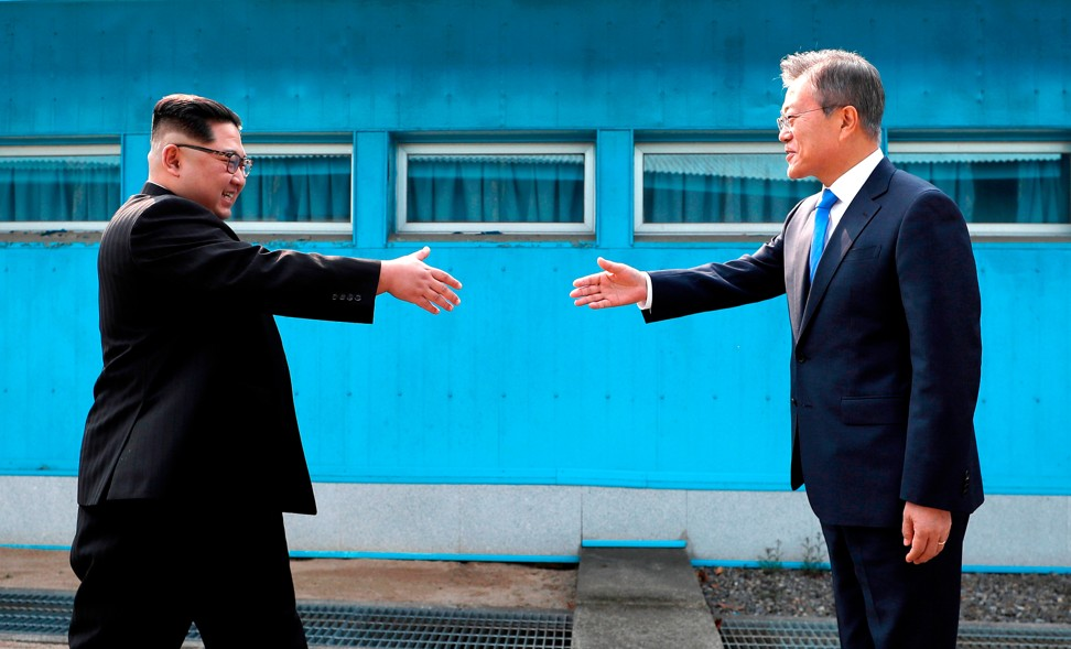 South korea preparing for summit with north korea and us diplomat north korean leader kim jong un and south korean president moon jae in greet each other over the military demarcation line in panmunjom photo ap m4hsunfo