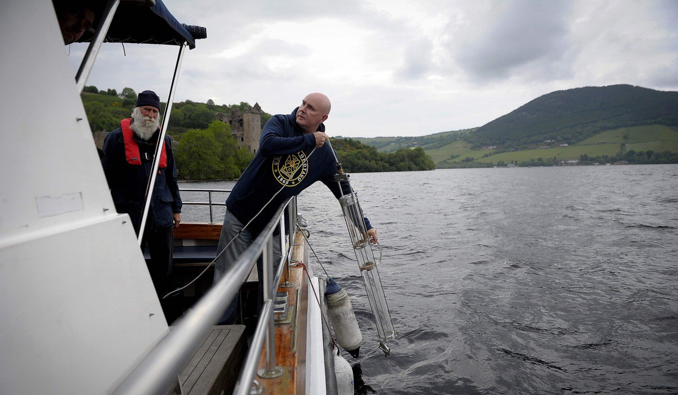 Professor Neil Gemmell taking samples on his boat on Loch Ness on June 11, 2018. Photo: AFP
