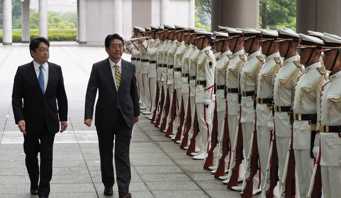 Shinzo Abe Indicates He Wants To Revise Japans Pacifist Merengue Dance Steps Diagram Galleryhipcom The Hippest Galleries Defence Minister Itsunori Onodera Left And Review An Honour Guard At Ministry On Monday Photo Afp