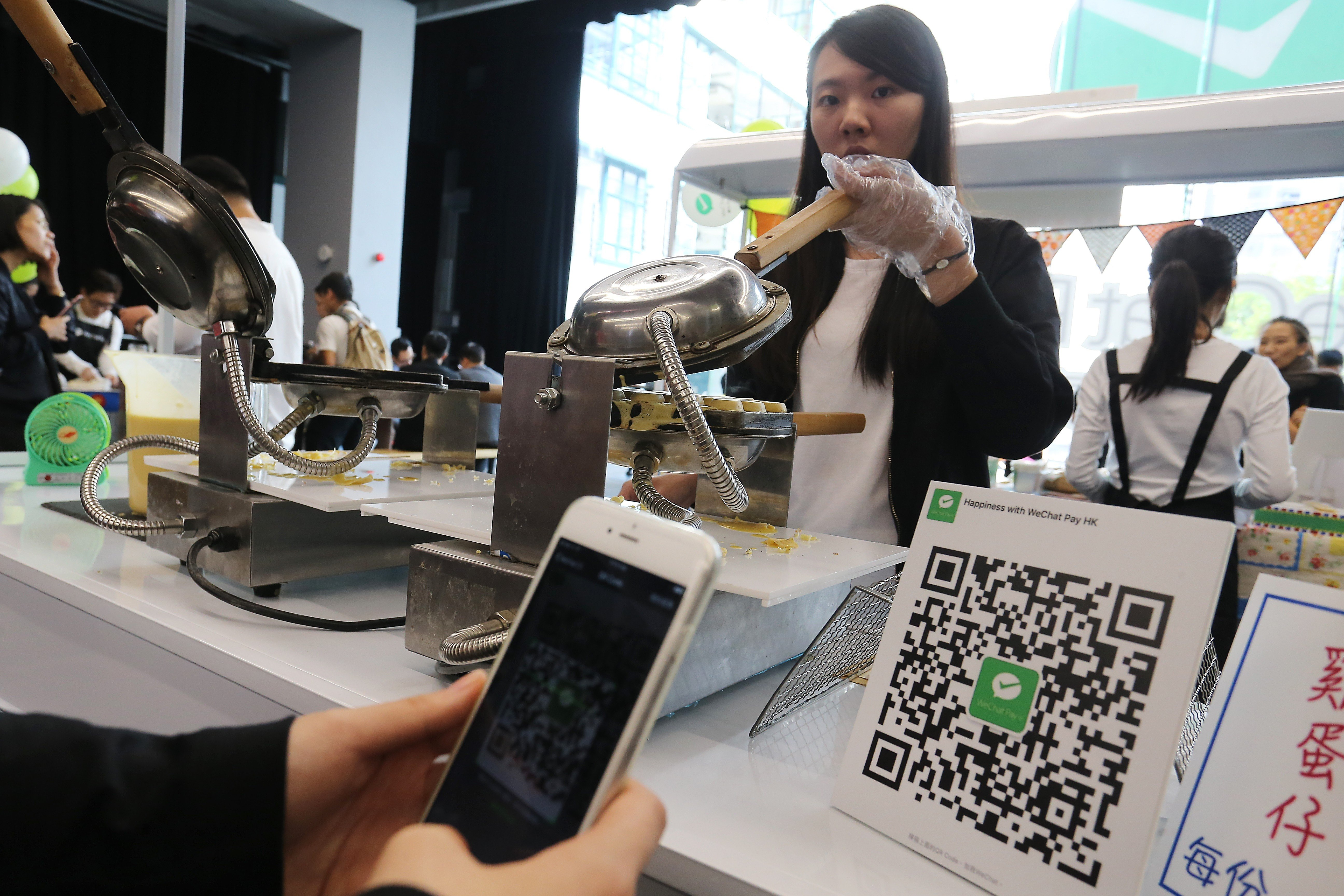 Singapore e-wallet NetsPay in talks with Tencent's WeChat Pay for
