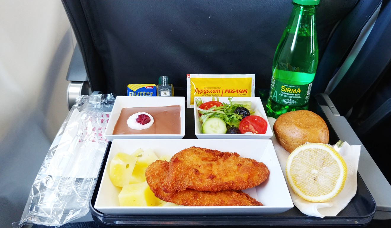 Pegasus Airlines' €11 meal: chicken schnitzel with potatoes, a Mediterranean salad and chocolate mousse. Photo: Nik Loukas