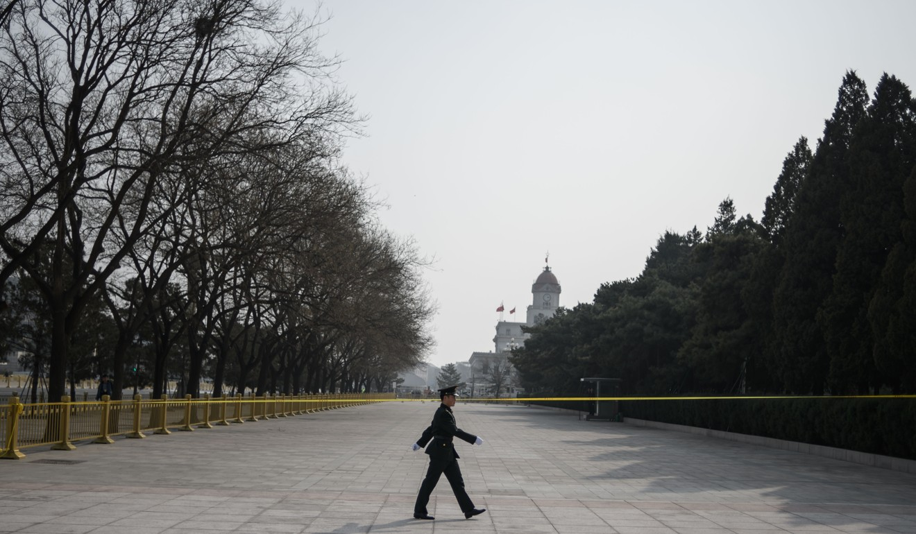 A Chinese paramilitary police officer patrols in front of the Great Hall of the People on Saturday on the eve of the opening session of the Chinese People's Political Consultative Conference in Beijing. Photo: AFP