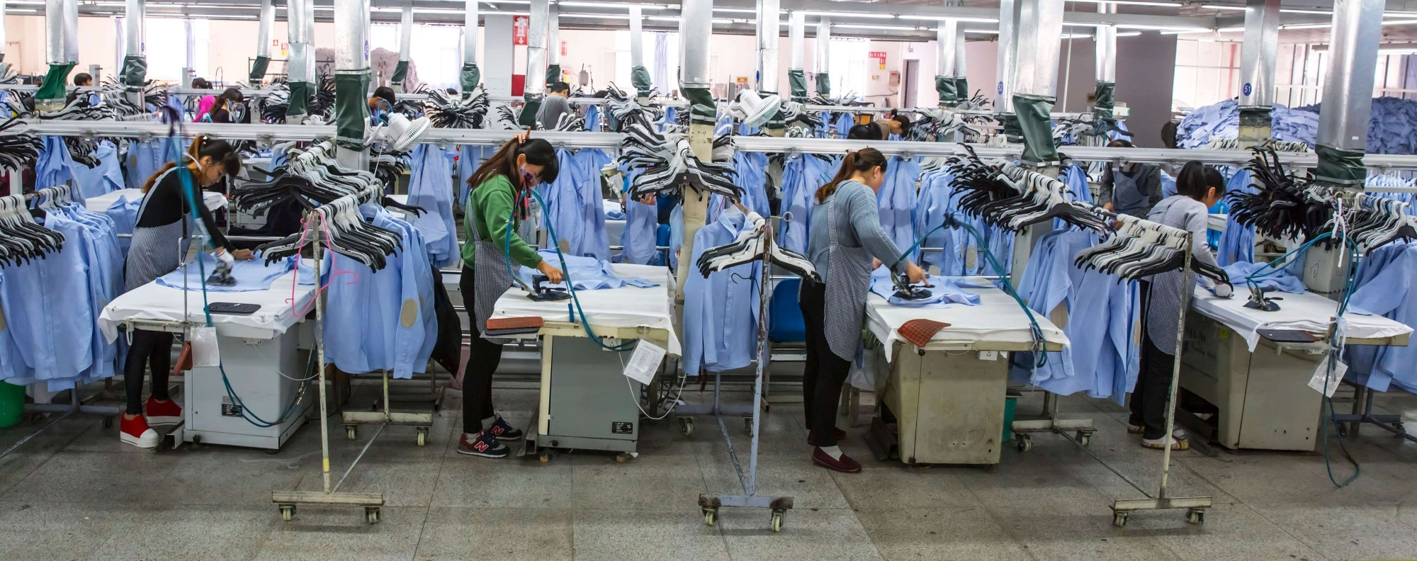 Women work in a shirt factory in China. Photo: AFP