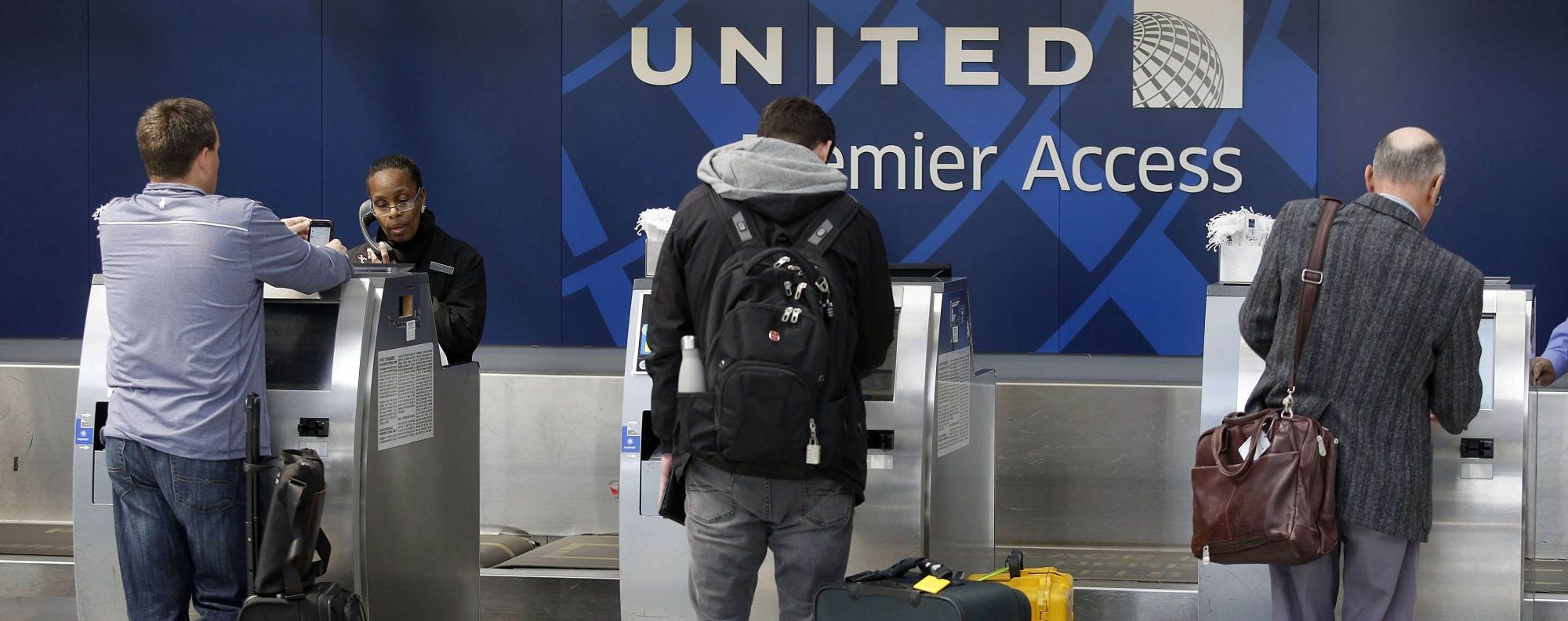 Travelers check-in at United Airlines at O'Hare International Airport. Photo; AFP