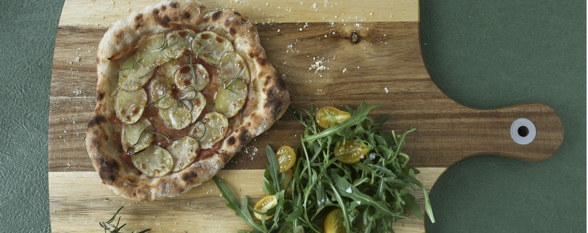 Pizza with potato, ham and rosemary. Photography: Jonathan Wong