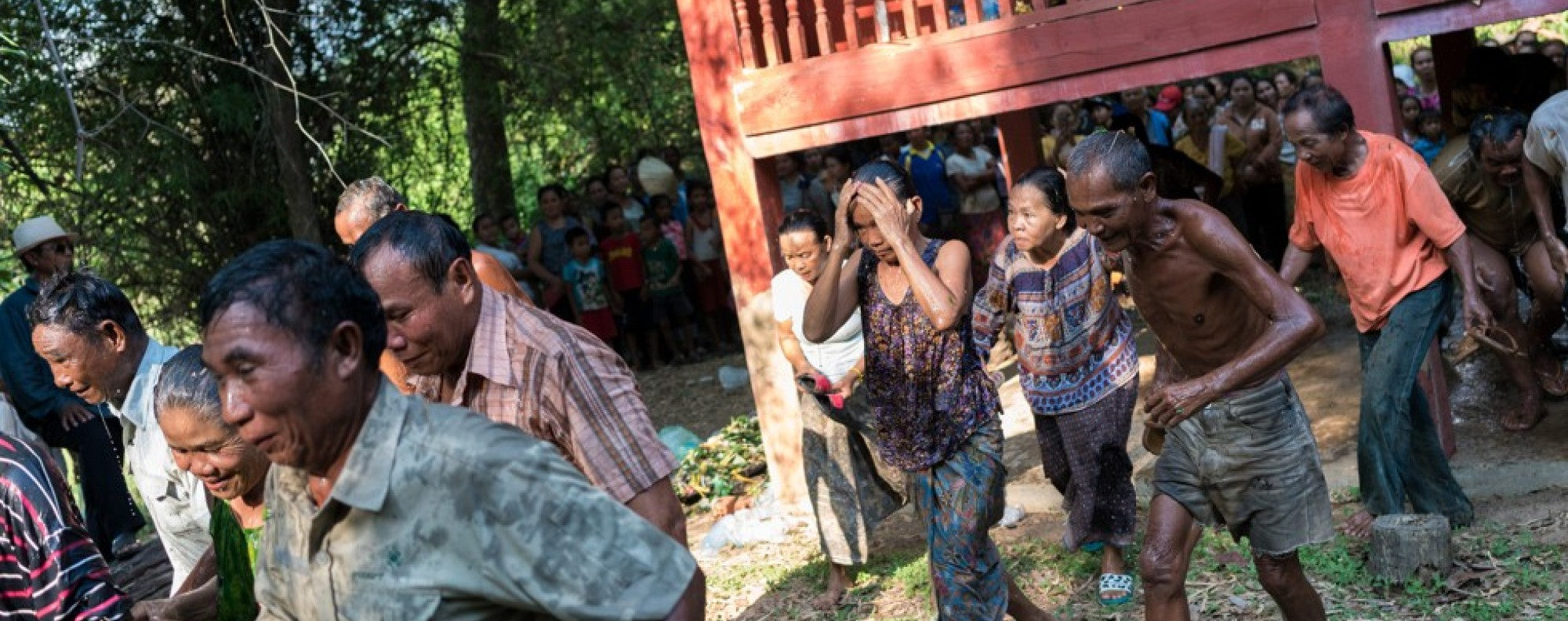 Villagers take part in a ritual to draw out the evil spirit known as Phi Pob, in Nakasang, Laos. Picture: Thomas Cristofoletti