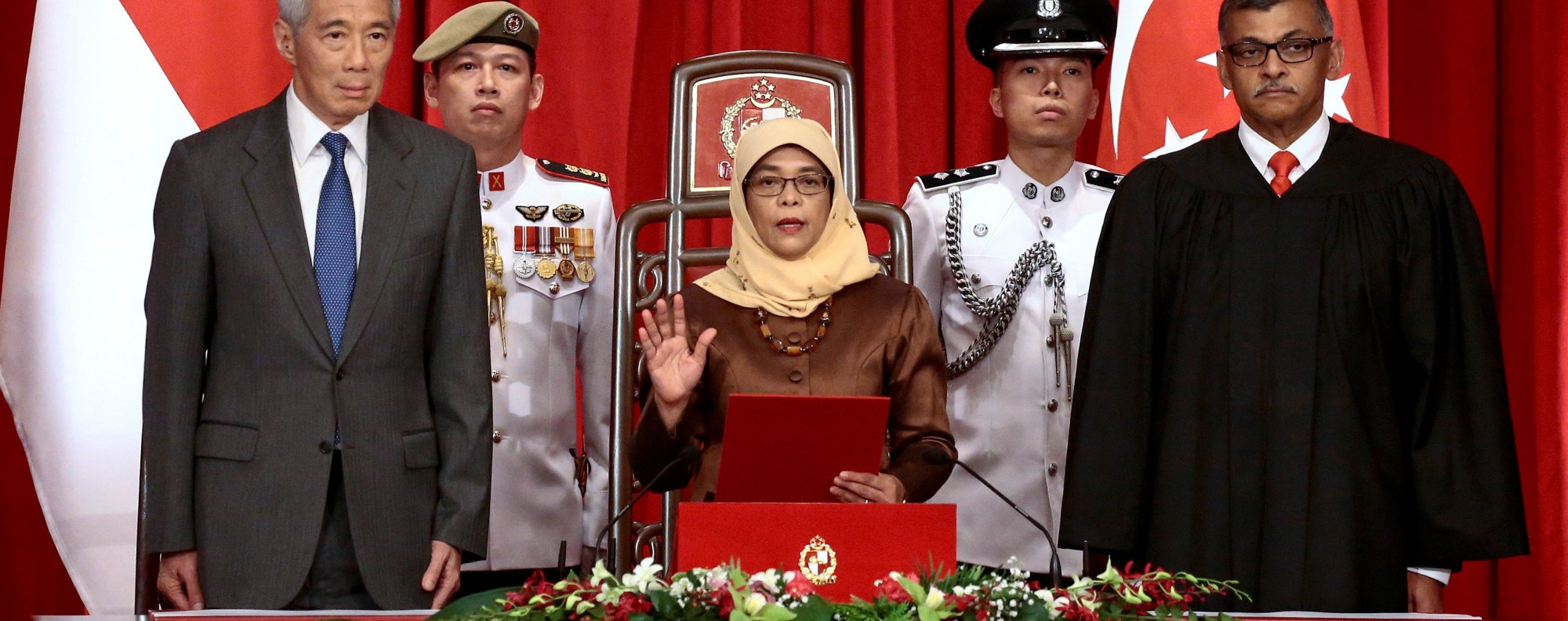Halimah Yacob takes the oath of office. Photo: Reuters