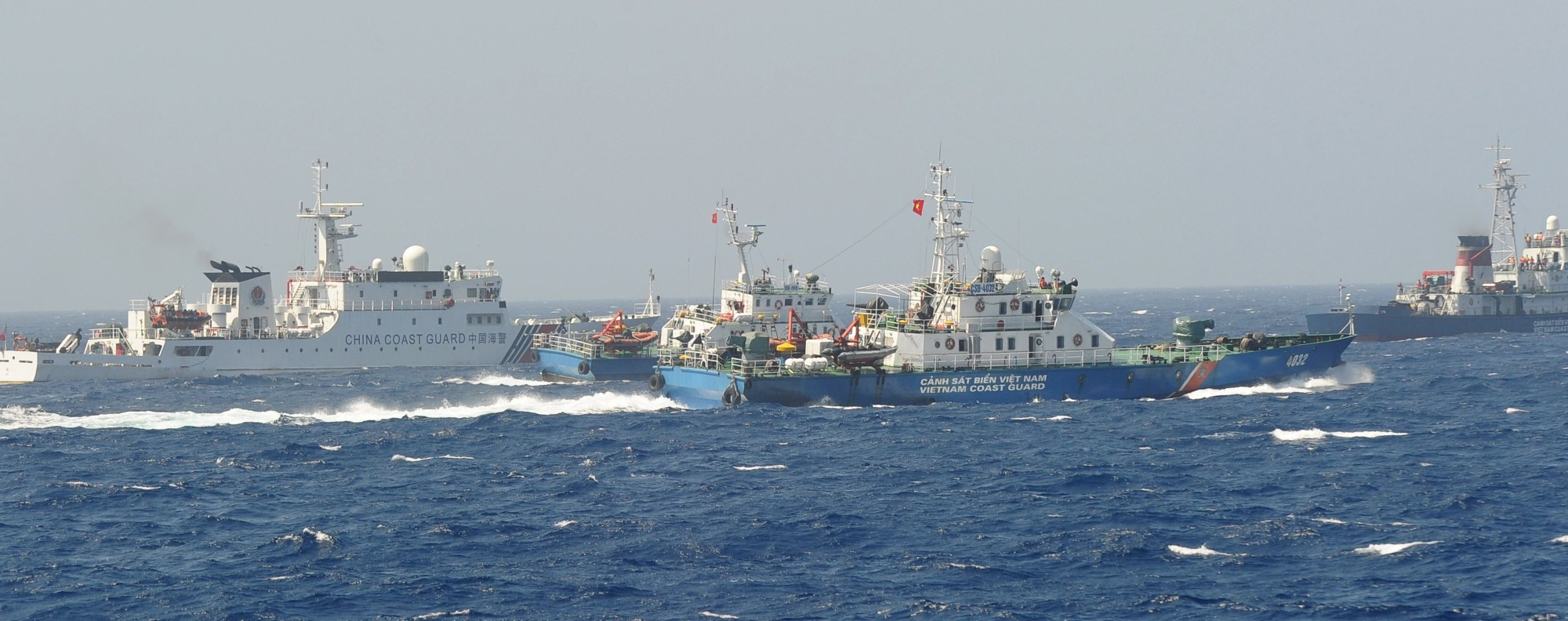 A Chinese coast guard ship being blocked by three Vietnamese coast guard vessels near China's oil drilling rig in disputed waters in the South China Sea. Photo: AFP