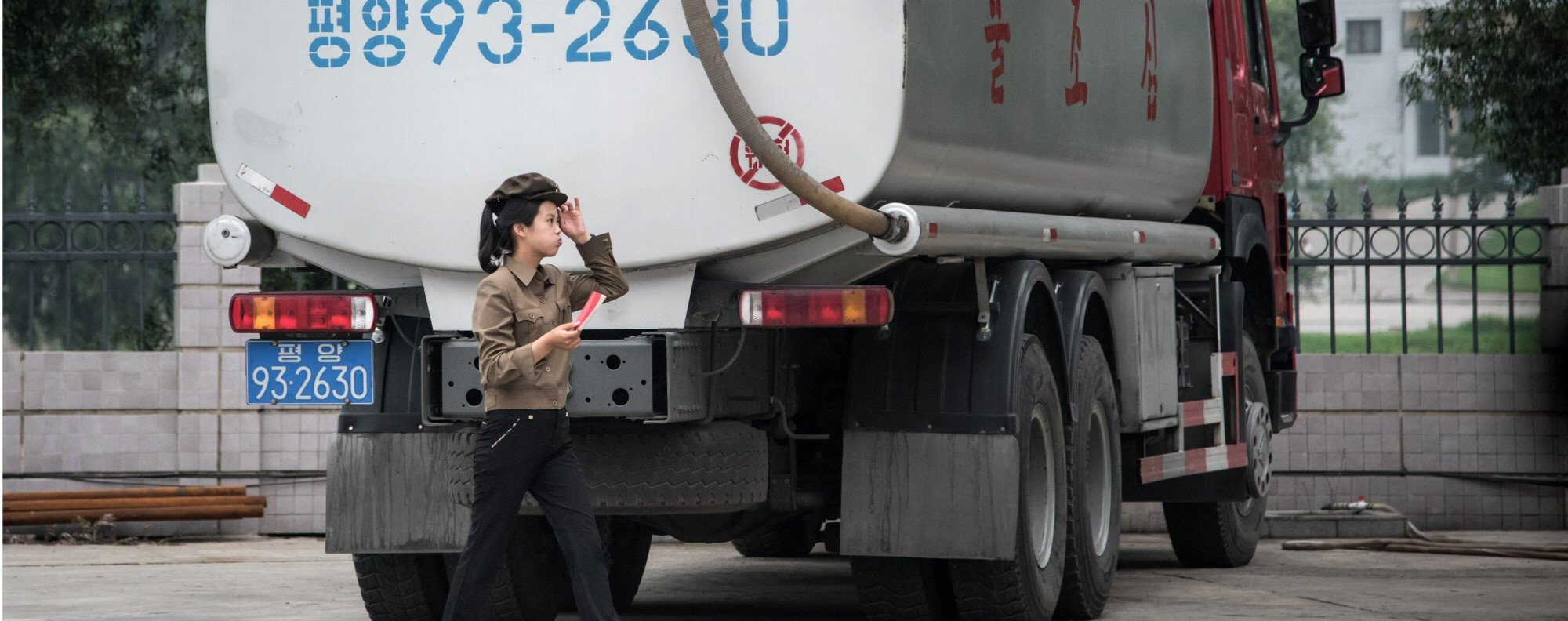 A petrol station worker and a fuel truck in Pyongyang. Photo: AFP