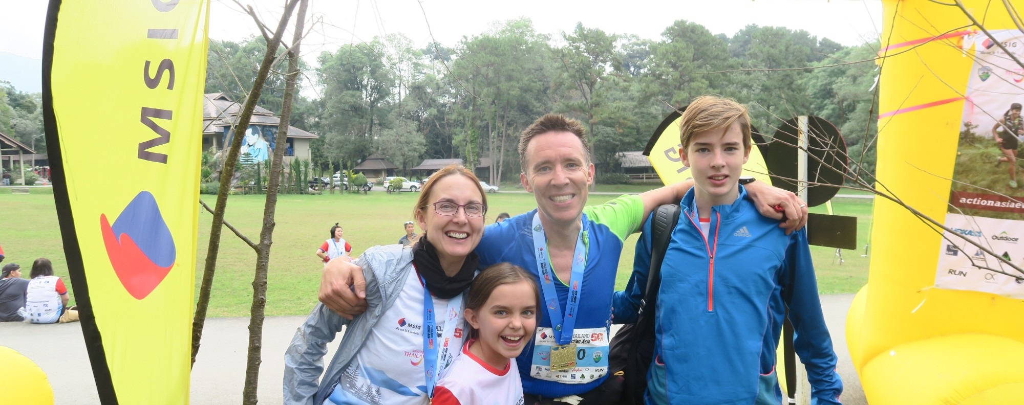 The Dingleys at the finish line in Chiang Mai in Thailand. Parents Jeana and Peter have encouraged their children to take up running to reduce time on social media. Photos: Action Asia Events