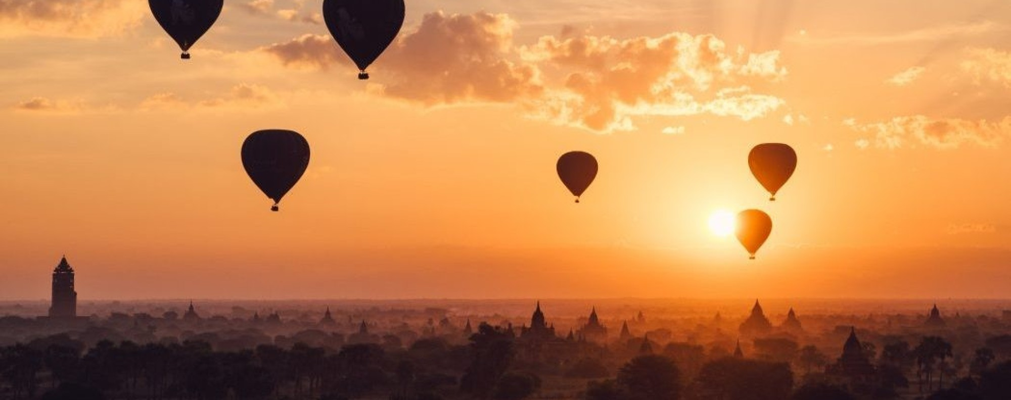 Hot-air balloons float in the sky during a stunning sunset above the ancient city of Bagan in Myanmar. Photo: Joel Sparks/Unsplash