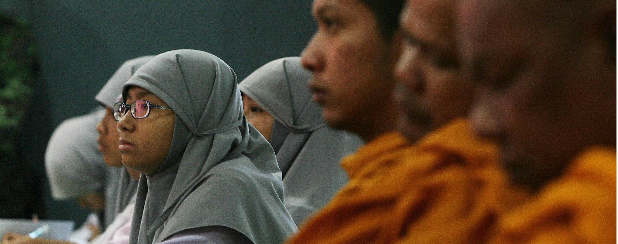 Monks and Muslims at an interfaith meeting. Photo: AFP