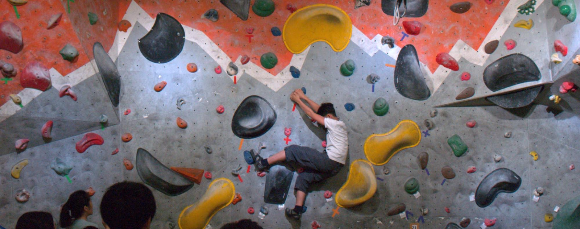 Owen Dong works his way through a bouldering problem. Photos: Mark Agnew