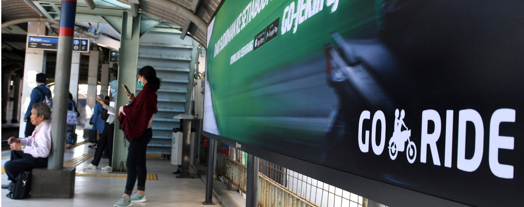 A Go-Jek advertisement at a railway station in Jakarta. Photo: AFP