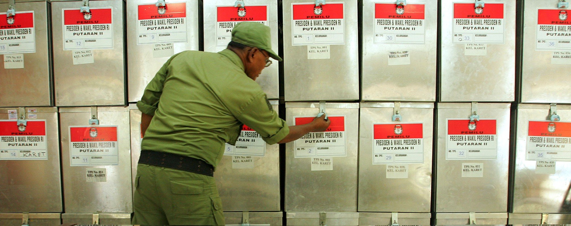 An election official prepares ballot boxes in Jakarta. Photo: Reuters
