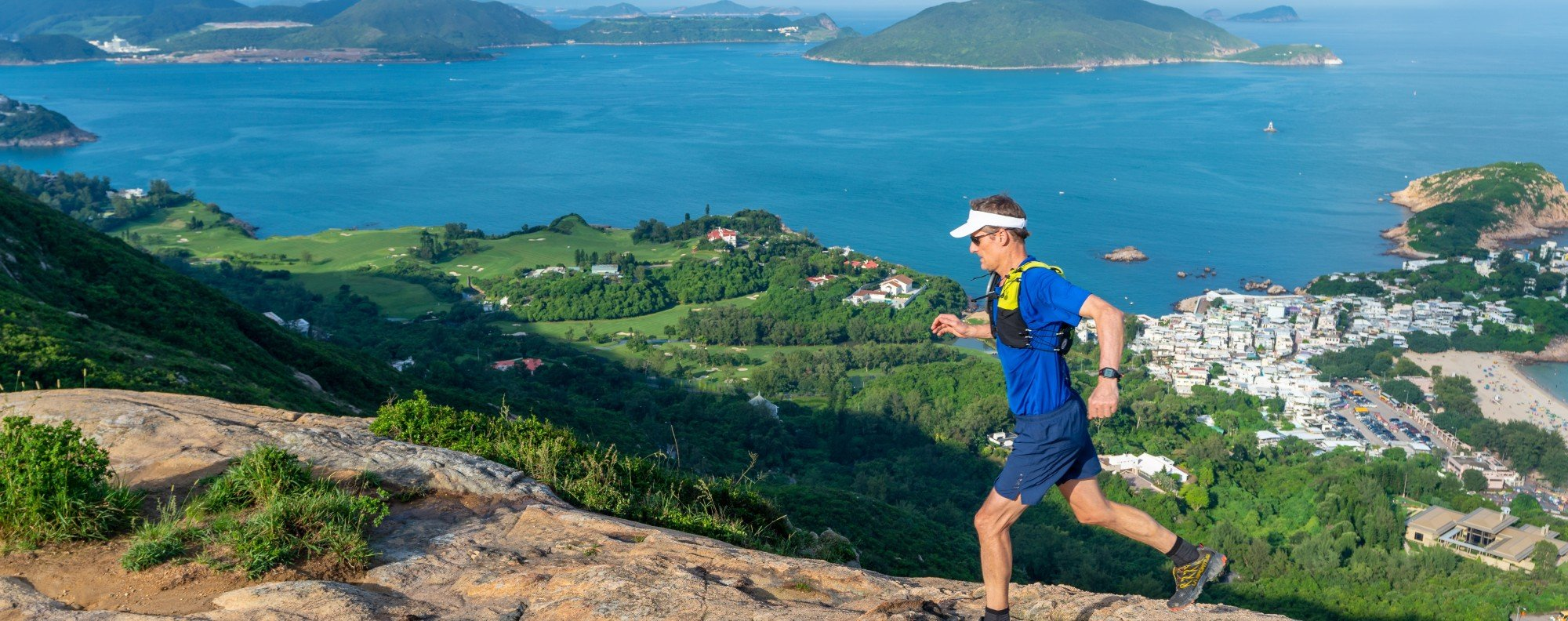 Mark Western became the first person to run around Hong Kong by hugging the coastline, sticking to the Shenzen border, and running around Lantau and Hong Kong Island. Photos: Handout