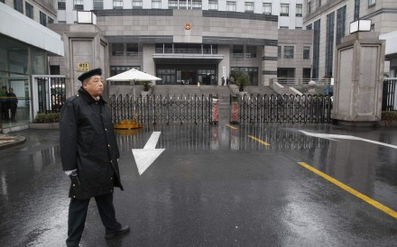A security guard stands in front of the Shanghai Pudong New Area People's Court in Shanghai. Photo: Reuters