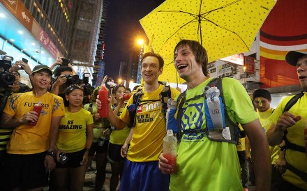 John Ellis (front left ) and Andrew Dawson arrive Mong Kok after they ran an ultramarathon course in the shape of a giant umbrella to support ongoing pro-democracy protests. Photo: K. Y. Cheng