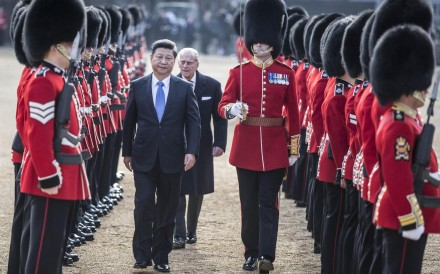 President Xi Jinping and Britain's Prince Philip inspect the guard of honour in London last month.