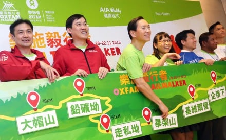 Organisers of the 100-kilometre Trailwalker charity race, including Bernard Chan (third from left), give a boost to the gruelling event. Photo: David Wong