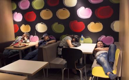 "Dubbed ""McRefugees"", people sleep at night in 24-hour McDonald's branches around Hong Kong due to homelessness. Photo: AP"