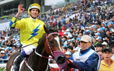 """Hugh Bowman gives the """"okay"""" sign after winning the BMW Hong Kong Derby aboard Werther. Photos: Kenneth Chan"""