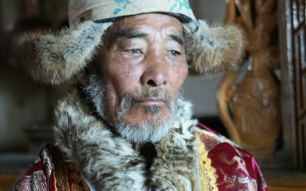 Denyoun Tsering, 80, one of the last remaining muleteers to have plied the Southern Silk Road, wearing his Tibetan clothes at home in Shangri-La, Yunnan. Photo: Paul Mooney