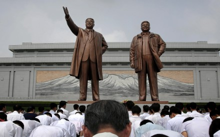 North Koreans bow in front of bronze statues of the late leaders Kim Il Sung and Kim Jong Il at Munsu Hill, Monday, July 27, 2015, in Pyongyang, North Korea. North Koreans gathered to offer flowers and pay their respects to their late leaders as part of celebrations for the 62nd anniversary of the armistice that ended the Korean War. (AP Photo/Wong Maye-E)
