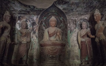 Statues of Buddha and his disciples dating from the Tang Dynasty, in one of the Mogao caves. Photo: Gilles Sabrié/The Washington Post