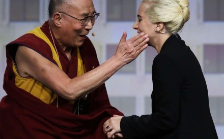 The Dalai Lama (left) greets Lady Gaga before they hold a question-and-answer session at the US Conference of Mayors in Indianapolis on Sunday. Photo: AP