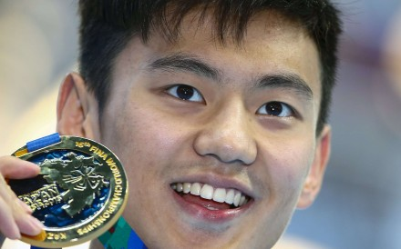 Ning Zetao of China poses with his gold medal after winning the men's 100m freestyle final at the Aquatics World Championships in Kazan, Russia in August 2015. Photo: Reuters