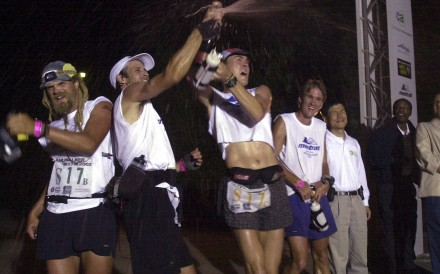 The Montrail Protreck team including Scott Jurek (third from left) celebrate their Trailwalker victory in 2002.