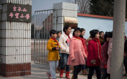 Children leaving a school in Chengde, Hebei province. China has a large gap in educational attainment between males and females. Photo: AFP