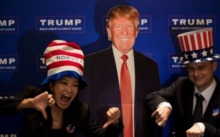 A couple poses next to a cardboard cutout of US presidential candidate Donald Trump during an election event organised by the US consulate in Shanghai on Wednesday. Photo: AFP