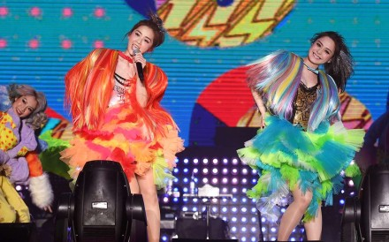 Charlene Choi (left) and Gillian Chung performing together as Twins.