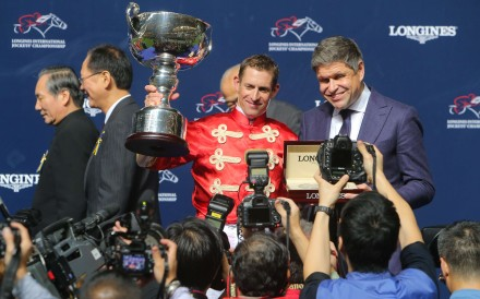Jockey Hugh Bowman collects his International Jockeys' Championship trophy. Photos: Kenneth Chan