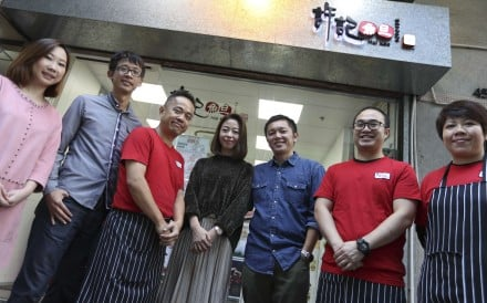 Husband and wife Niki Tang and Alfred Hui (fourth and fifth from left) with staff at one of Hui Kee's Cheung Sha Wan outlets. Pictures: Nora Tam