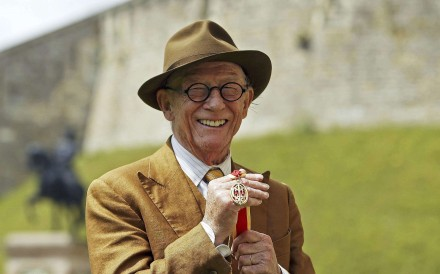 British actor John Hurt poses with his award after receiving a knighthood. Photo: Reuters