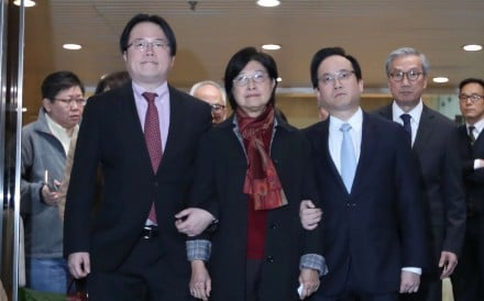 Former chief executive Donald Tsang's wife, Selina Tsang Pou Siu-mei, flanked by her two sons. Photo: Nora Tam