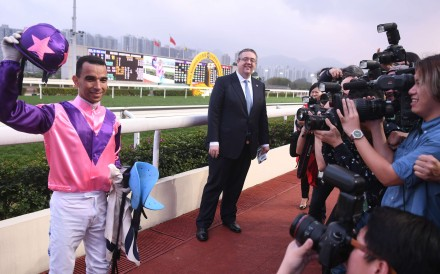 Joao Moreira poses for local press at Sha Tin on Sunday after riding eight winners, a record for most wins in one day in Hong Kong. Photos: Kenneth Chan.