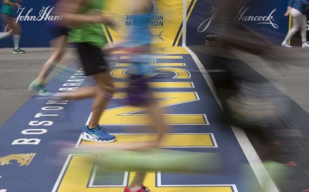 Runners crossing the finish line of the 121st Boston Marathon in 2017. Photo: EPA