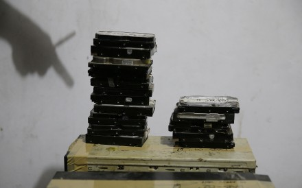 Computer hard drives seized during a raid on the home of suspected child webcam sex operator David Timothy Deakin. Photo: AP