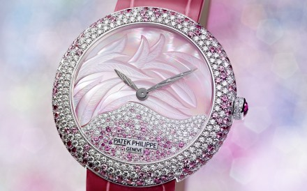 Patek Philippe's Calatrava Haute Joaillerie Ref. 4899 is decorated with a mother-of-pearl dial and a mixture of diamonds and rose sapphires.