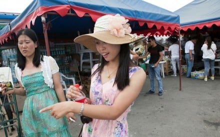 A file picture of Chinese tourists shopping on the border with Kazakhstan. Photo: Handout